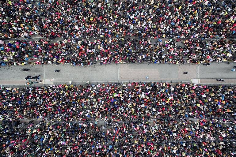 2 February 2016: An overhead view of tens of thousands of people waiting to enter Guangzhou Railway Station because of weather delays- Lin Hongxian/Southern Metropolis Daily/Reuters