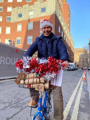 santa-on-bike-delivering-presents-sustainable